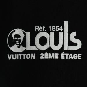 LOUIS VUITTON WITH RED AND BLUE LOGO BADGE